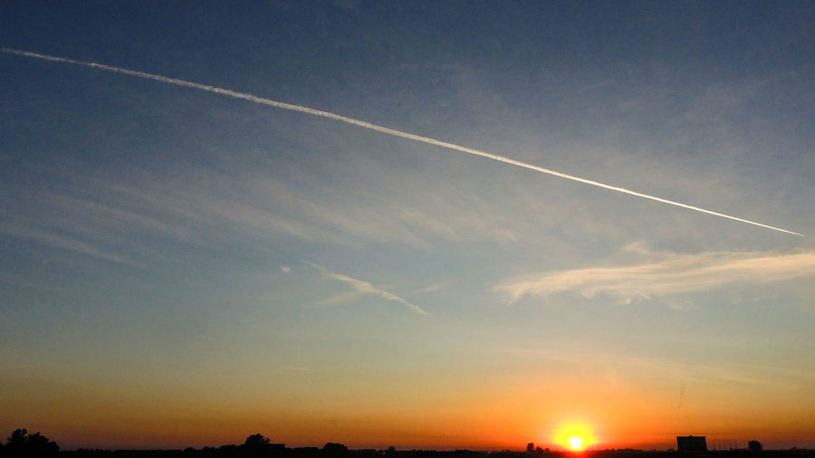 Airplane Vapour Trail Beauty In Nature Contrail Day Nature No People Outdoors Scenics Silhouette Sky Sunset Vapor Trail