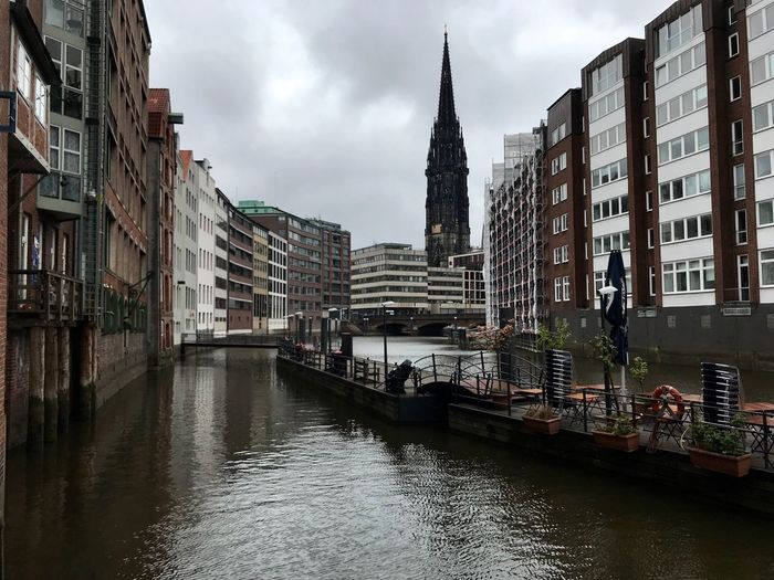 Canal passing through buildings in city