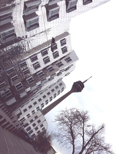 Man flying in front of building