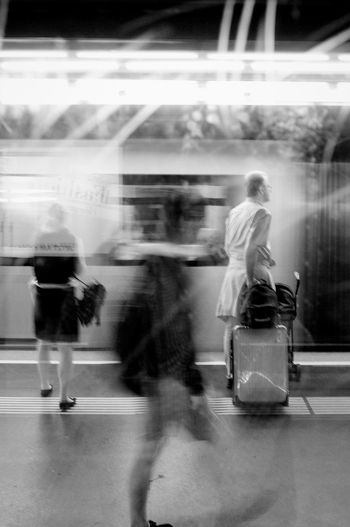 Metro Austria City Metro Vienna Blurred Motion Group Of People Illuminated Incidental People Lifestyles Metro Station Monochrome Motion on the move Real People Rear View Streetphotography Transportation Travel Waiting