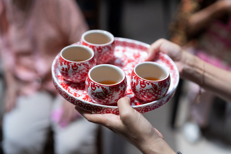 Tea ceremony during Chinese traditional wedding. Happiness Respect Wedding Chinese Wedding Cup Drink Drinking Focus On Foreground Hand Holding Human Body Part Human Hand Real People Tea Ceremony Tea Cup Traditional