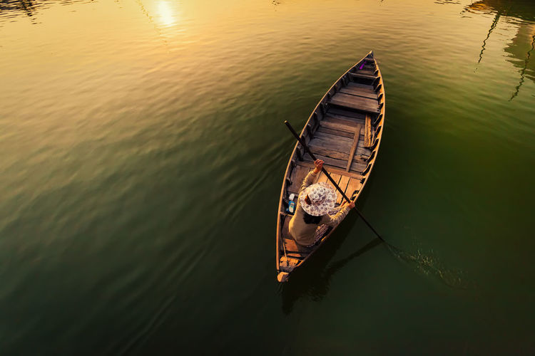 High Angle View Of Woman On Boat Swimming In River