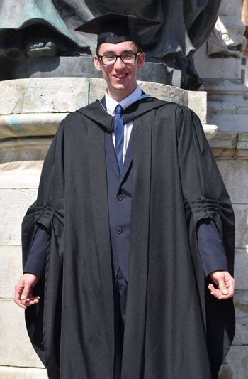 Hull University student Daniel Medcalf graduates - 12th July 2017 (Queen Victoria Square, Hull) Day Eyeglasses  Front View Gown Graduate Graduation Happiness Hull Hull University Lifestyles Looking At Camera Mortar Board One Person Outdoors People Portrait Real People Robes Smiling Standing Well-dressed Young Adult