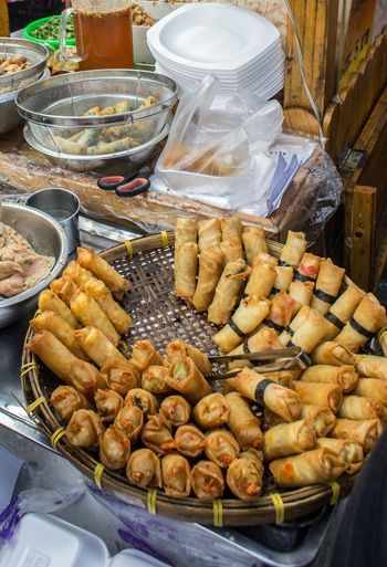 High angle view of fresh spring rolls in wicker basket at market stall