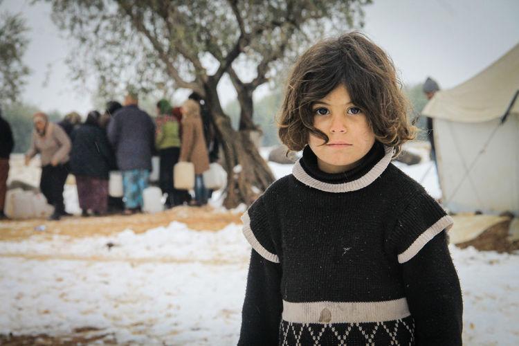 Portrait of teenage girl standing in snow