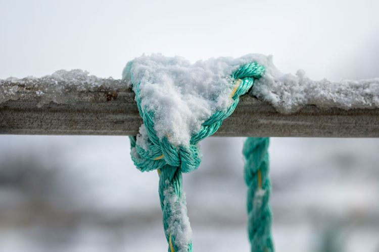 Close-up of snow on rope