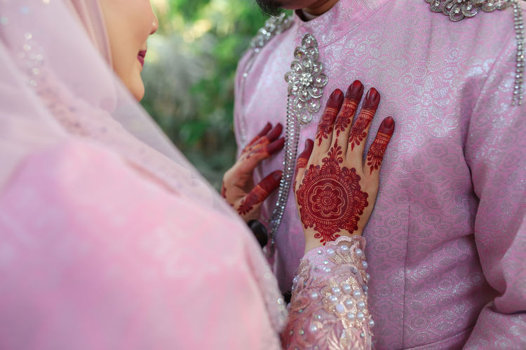 Bride Wedding Newlywed Celebration Wedding Dress Event Bonding Couple - Relationship Traditional Ceremony Floral Pattern Love Togetherness Henna Pink Color Malaysia Malay Wedding Culture ASIA Wedding Ceremony Clothing Traditional Clothing