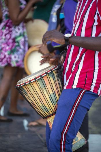 Midsection of man playing tabala