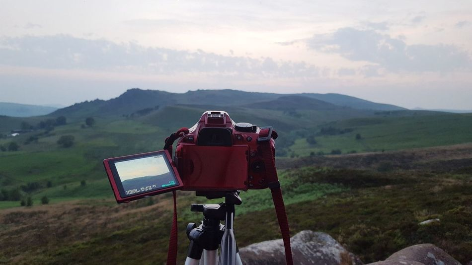 Photography Themes Mountain No People Red Landscape Sky Vacations Camera - Photographic Equipment Nature Sport Outdoors Day Close-up Film Industry Nature Agriculture Focus On Foreground Viewpoint View Into Land View Rural Scene Field Beauty In Nature Green Color