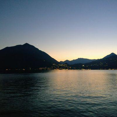 Lake Como post sunset. Water Mountain Sunset Lake City Sky Landscape Mountain Range Dramatic Sky Calm Idyllic Silhouette Shore