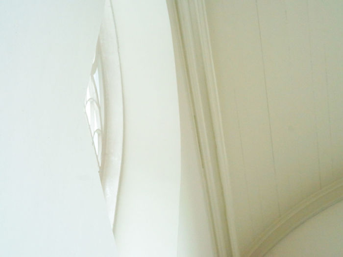 High angle view of white curtain against wall