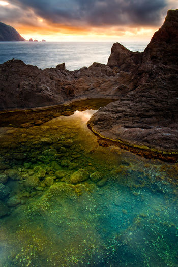 Colors Gold Madeira Sunset_collection Travel Beauty In Nature Cloud - Sky Clouds Day Golden Hour Landscape Long Exposure Mountain Mountain Range Nature No People Outdoors Rock - Object Scenics Sky Sunset Tranquil Scene Tranquility Travel Destinations Water