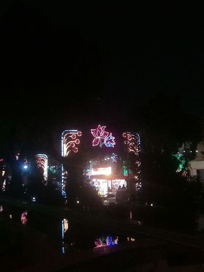 walking around the village, party time HUAWEI Photo Award: After Dark City Illuminated Arts Culture And Entertainment Multi Colored Sky Firework - Man Made Object Entertainment Firework Display Street Art Stage Light Popular Music Concert Music Concert Glowing Long Exposure