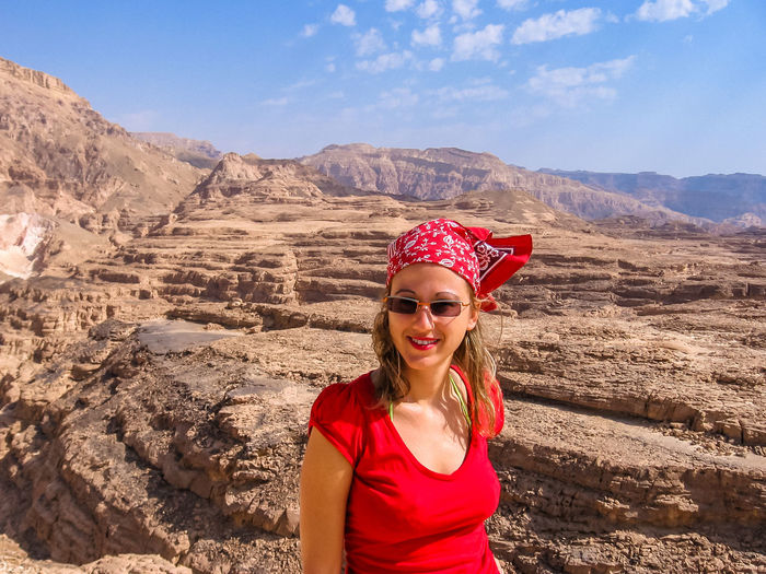 Portrait Of Woman Wearing Sunglasses While Standing Against Mountains