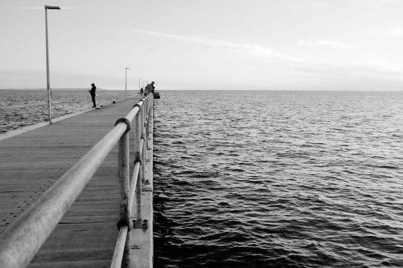 EyeEm Selects Sea Water Horizon Over Water Beach Nature Tranquil Scene Scenics Tranquility Outdoors Day Fishing Pole Beauty In Nature Real People Leisure Activity Sky Fishing Men Vacations One Person People