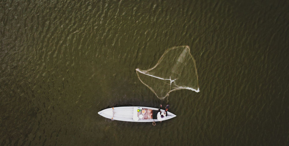 High angle view of boat floating on lake