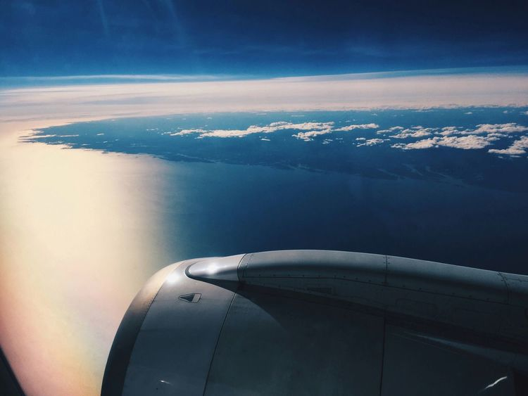 Flying high over the coast of Norway, sea and sunlight before sunset Aerial View Journey Airplane Airplane Wing Aircraft Wing Jet Engine Flying Flying High From Above  Coastline Coast Sunlight Travel Sea Sky Beauty In Nature No People Nature Transportation Cloud - Sky Altitude Above Blue Norway🇳🇴 Fjord