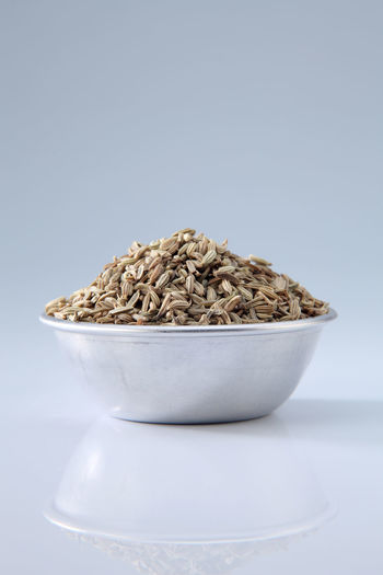 close up of the bowl cumin seeds on white background Spice Seed Cumin Ingredient Medicine Seasoning Scented Aromatic Food Food And Drink Indian Food Condiment Healthy Eating Dried Food Flavor No People Container Bowl Still Life Heap White Background Studio Shot Copy Space Cut Out Close-up