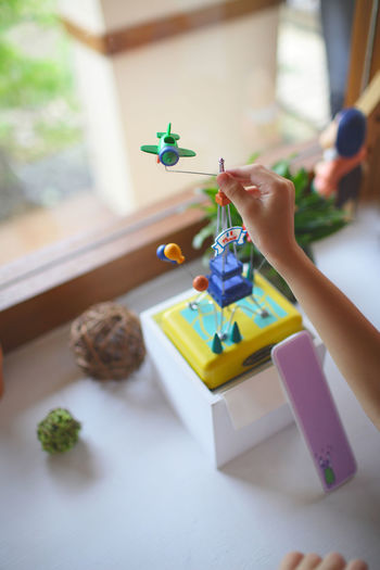 Hand-made toy set Human Hand Hand One Person Human Body Part Holding Childhood Real People Playing Toy Indoors  Focus On Foreground Creativity Leisure Activity Unrecognizable Person Day Lifestyles Body Part Plant Table Finger Handmade Hand-made Hand Made Window Light And Shadow Natural Light Boy Girl Joy Enjoying Life Morning Shop