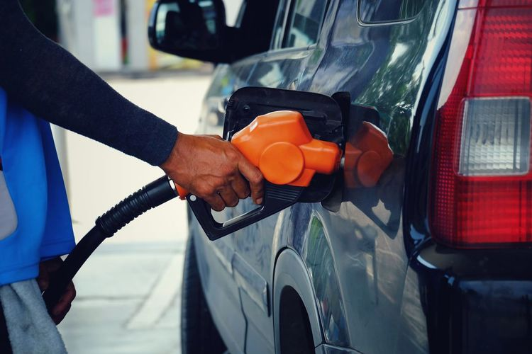 Worker hand holding nozzle fuel fill oil into car tank at gas station Environment Car Energy Station Industry Petroleum Petrol Service Gas Gasoline Automobile Tank Business Benzine Save Transport Expensive Power Technology Transportation Cost Oil Fuel Refuel Vehicle