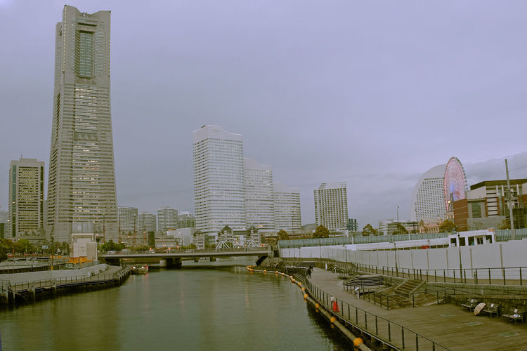 Downtown Yokohama Architecture Building Building Exterior Built Structure Canal City City Life Cityscape Cloud - Sky Day Development Modern Nature No People Office Building Outdoors Residential District River Sky Skyscraper Tall - High Travel Destinations Urban Skyline Water Waterfront