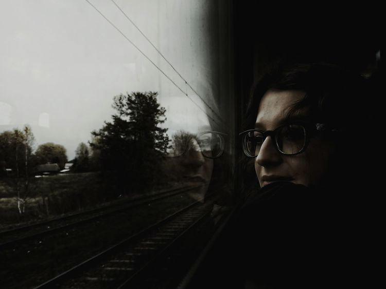 I wanted it darker, I killed the frame. Woman Portrait EyeEm Selects darkness and light Dark Portrait Train Journey Looking Through Window Only Women One Person Transportation One Woman Only Adults Only Train - Vehicle