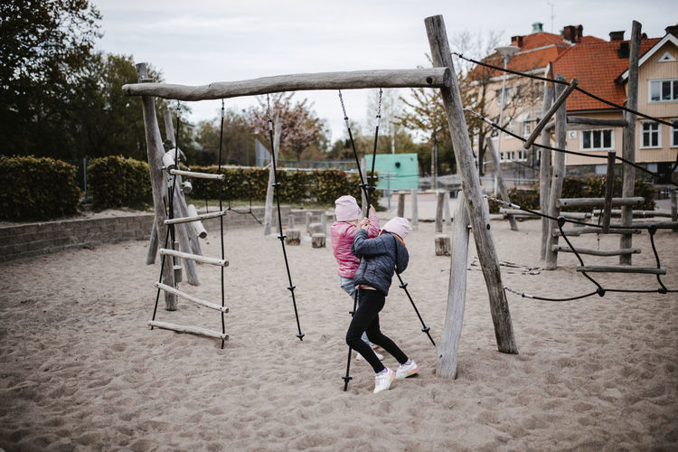 Full length rear view of woman in playground