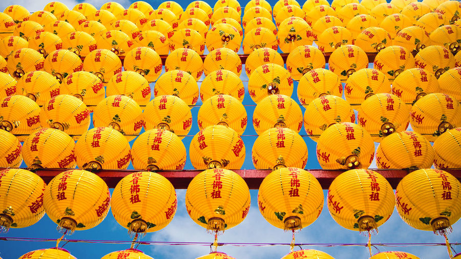 Yellow Chinese lantern wall ASIA Wall Abundance Buddhism Chinese Lantern Culture Day Decoration Festival Hanging In A Row Lantern Large Group Of Objects Low Angle View Outdoors Pattern Repetition Sky Tourism Tradition Yellow