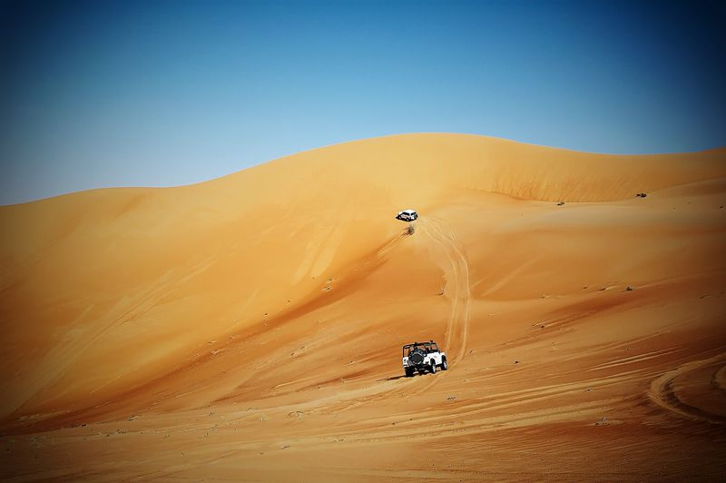 People dune bashing with their off-road vehicles in the desert of Abu Dhabi Emirates, United Arab Emirates 🇦🇪 Desert Sand Dune Sand Off-road Vehicle Transportation Landscape Arid Climate Mode Of Transport Car 4x4 Clear Sky Sunny Land Vehicle Outdoors Nature Scenics Day