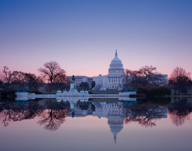 Sunrise at the US Capitol building in the capital city of Washington DC in the USA Capitol DC Government Reflection Skyline US Capitol US Capitol Building USA Washington Washington DC Washington, D. C. Capital Clear Sky Congress Dawn Dome Government Lake Outdoors Pool Standing Water Sunrise