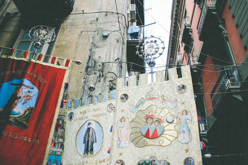 Naples Napoli Architecture Art And Craft Building Building Exterior Built Structure Creativity Culture And Tradition Cultures Day Floral Pattern Folklore Hanging Human Representation Low Angle View Mural No People Outdoors Representation Streetphotography Text Wall Wall - Building Feature Window