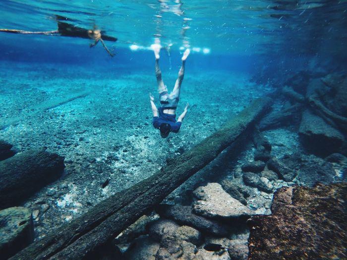 Man Diving In Sea