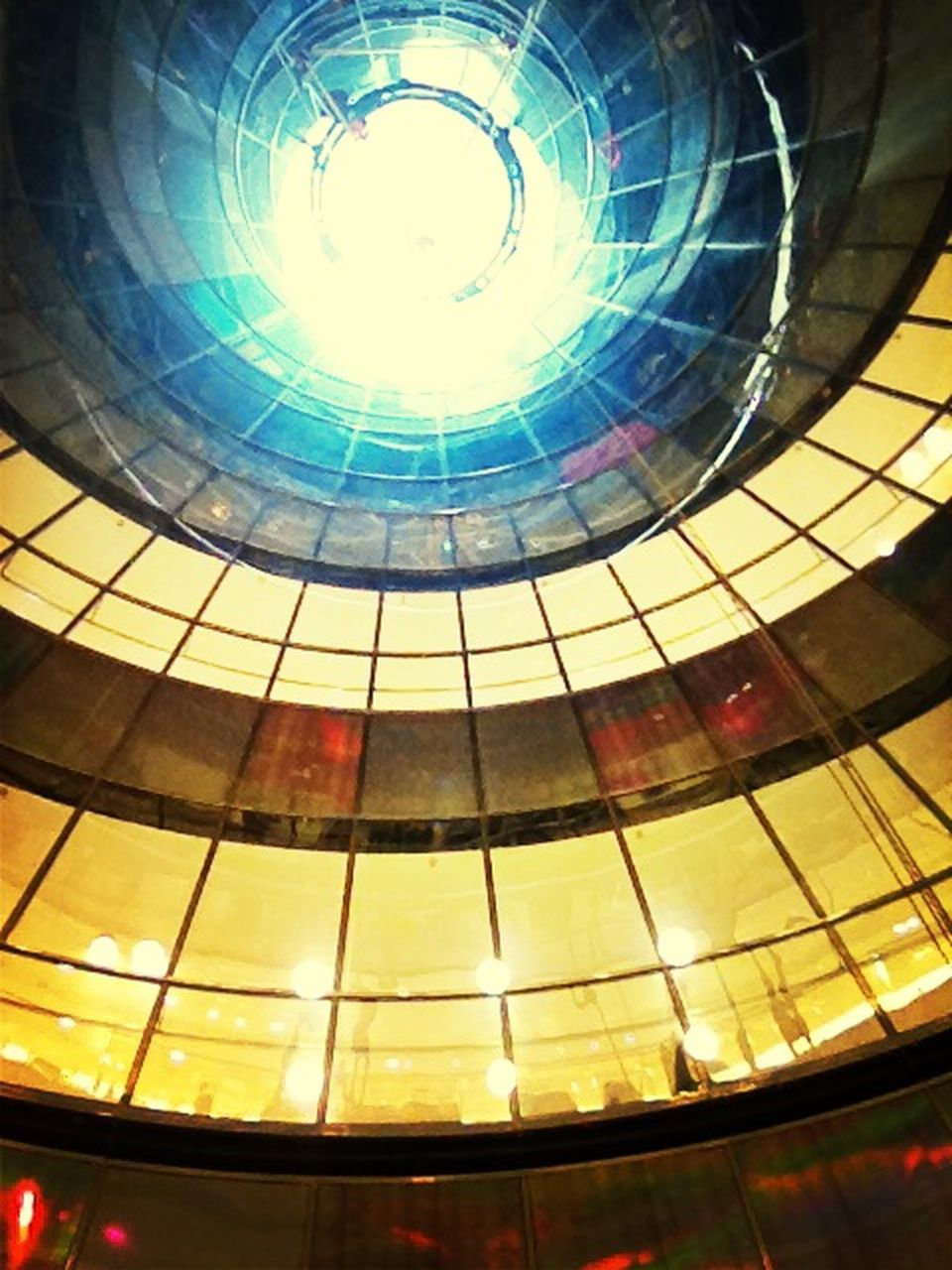 architecture, low angle view, built structure, sunlight, lens flare, fish-eye lens, indoors, sun, building exterior, no people, sky, dome, modern, day, city, close-up