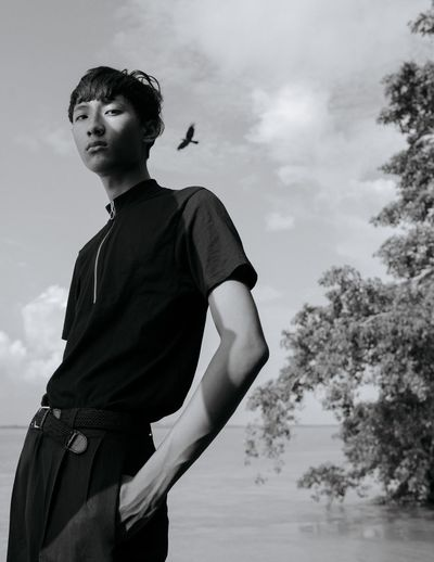 Black & White Composition EyeEm Adolescence  Bird In Flight Casual Clothing Cloud - Sky Contemplation Fashion Model Fashion Photography Focus On Foreground Lifestyles Light And Shadow Nature Outdoors Portrait Portrait Photography Real People Sky Teenage Boys Teenager Tree Young Men