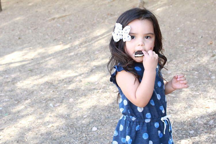 Portrait of girl eating cake