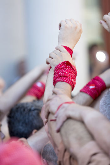 Close-up of hands with wristbands