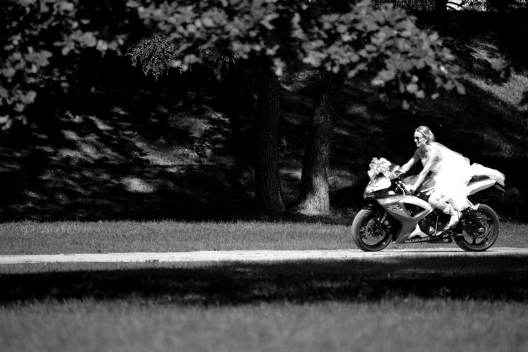View of man riding motorcycle