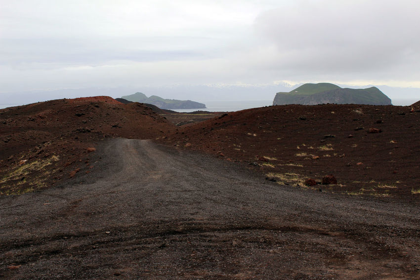 A road through the lava fields on Heimaey Island in Iceland. Heimaey Iceland Arid Climate Beauty In Nature Climate Cloud - Sky Environment Iceland_collection Landscape Mountain Nature No People Non-urban Scene Outdoors Physical Geography Remote Road Scenics - Nature Sky Tranquil Scene Tranquility Volcano Westman Island