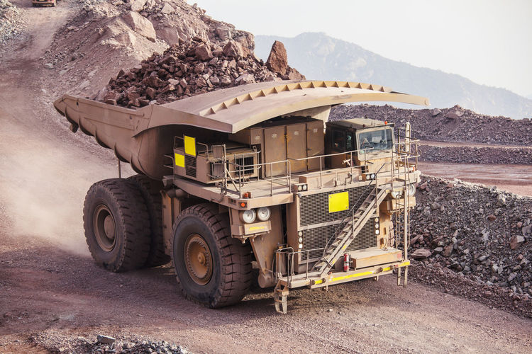 Mining Activity, mining dump truck Chile Earth Heavy Industrial Industry Minerals Road Copper  Day Dump Dump Truck Earth Mover Front View Full Loading Mine Mineral Mining Mining Industry Outdoors Quarry Quarry Rock Side View Truck Vehicle