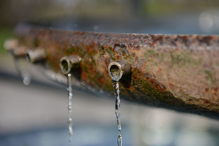 Water drops on rusty metal
