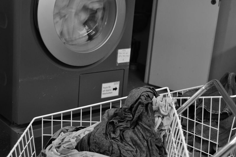 Close-up of laundry in basket against washing machine