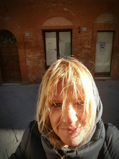 Me at Montalcino - sunny, windy but very cold!!! One Person Close-up Walking Around Enjoying Life Getting Inspired Hello World Atmosphere Relaxing Moments Getting Creative Taking Pictures From My Point Of View Semplicity Portrait Of A Woman That's Me :) Blond Hair Self Portrait Light And Shadow Sunny Winter Day Windy