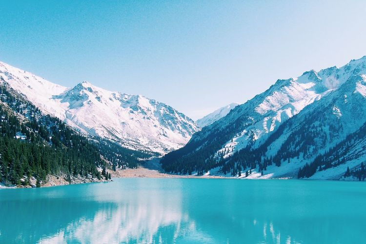 Beauty In Nature Blue Clear Sky Cold Temperature Day Frozen Iceberg Lake Mountain Mountain Range Nature No People Outdoors Scenics Sky Snow Snowcapped Mountain Tranquil Scene Tranquility Water Winter
