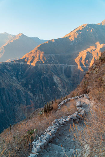 Magic Light in Colca Canyon Capture Tomorrow Colca  Canyon Peru Sunset Golden Hour Landscape Mountain Scenics - Nature Beauty In Nature Mountain Range Tranquility Environment Nature Outdoors Sunlight Lightrays Southamerica Adventure Hiking Trekking Epic Blue Orange Valley