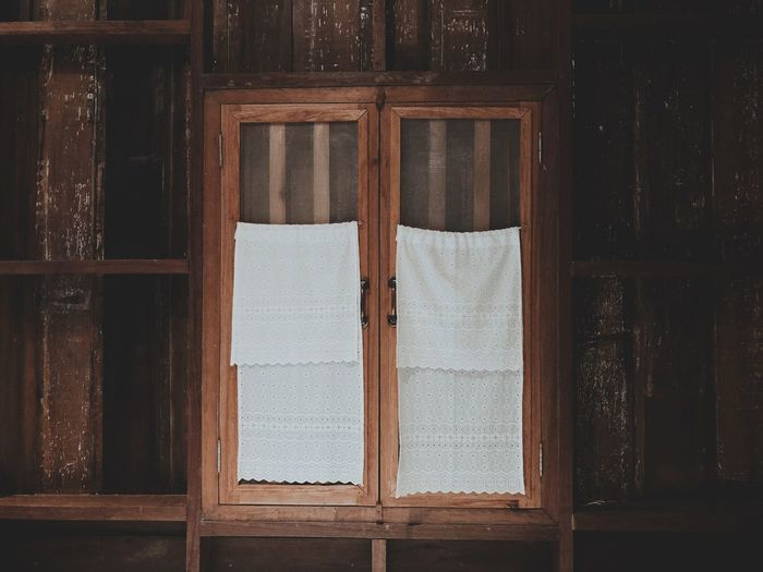 White Fabric Hanging On Window