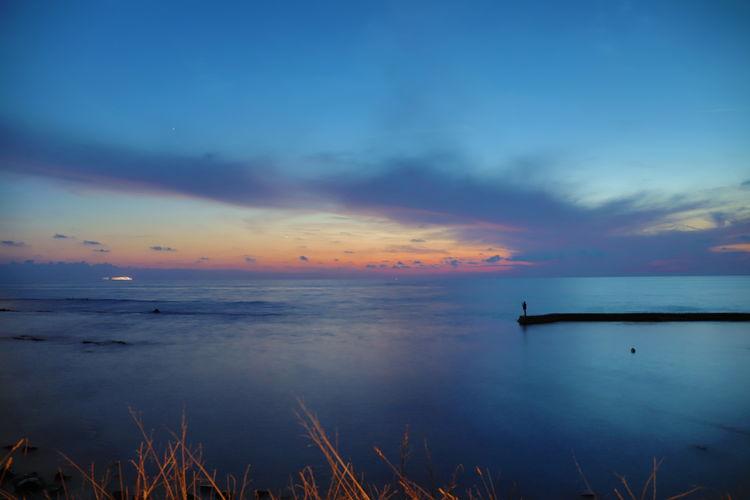 EyeEmNewHere Beach Beauty In Nature Cloud - Sky Horizon Horizon Over Water Idyllic Nature No People Non-urban Scene Orange Color Outdoors Scenics - Nature Sea Silhouette Sky Sunset Tranquil Scene Tranquility Water