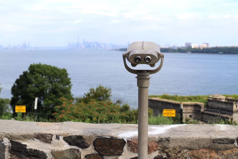 A view from across the pond Staten Island Skyline Waterfront Views NYC Photography NYC Fort Wadsworth Sky Coin Operated Binoculars Water Nature Coin-operated Binoculars No People Day Cloud - Sky Plant Architecture City Focus On Foreground Lake Outdoors Tree Security Surveillance Built Structure