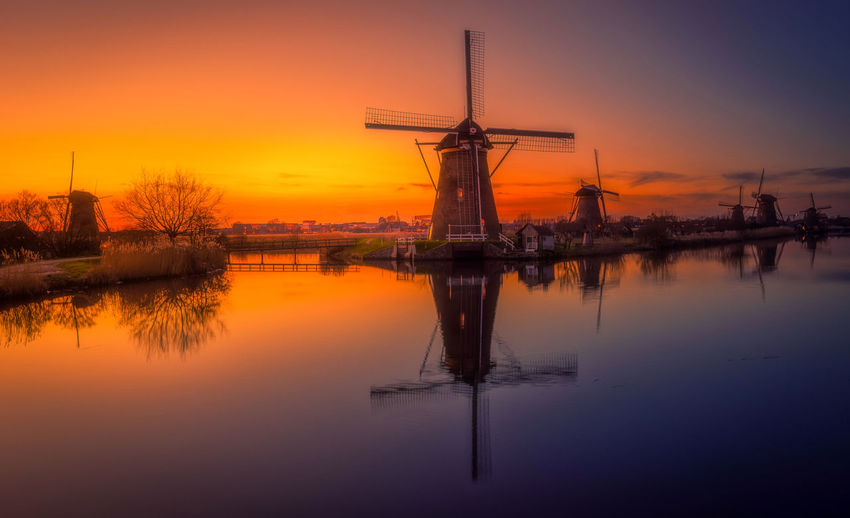 Remo SCarfo Amsterdam Kinderdijk Sunset Golden Hour Windmills EyeEm Best Shots EyeEmNewHere Reflection Water Sky Beauty In Nature Fuel And Power Generation Orange Color Scenics - Nature Tranquility No People Waterfront Nature Tranquil Scene Wind Turbine Turbine Environment Lake Wind Power Standing Water