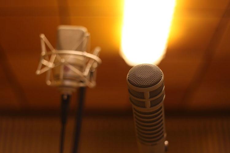 Close-up of microphones in recording studio