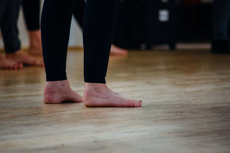 Low Section Human Leg Body Part Human Body Part barefoot One Person Flooring Standing Performance Indoors  Dancing Ballet Real People Ballet Dancer Hardwood Floor Wood Lifestyles Limb Focus On Foreground Human Limb Human Foot Tiptoe Stage